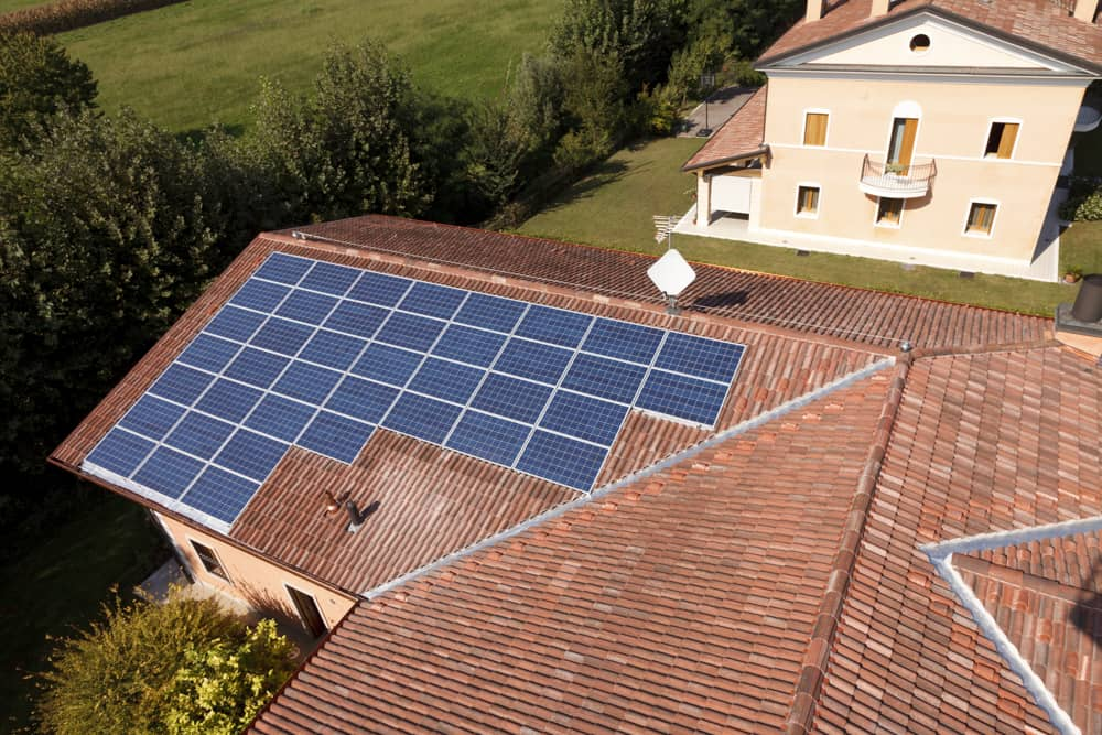 A bird's eye view of a rooftop with a solar panel array