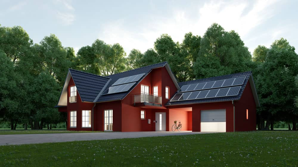 Photo of a red house with solar panels on the roof